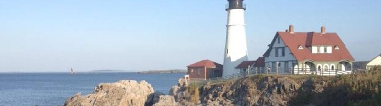 A lighthouse on a beach by the ocean