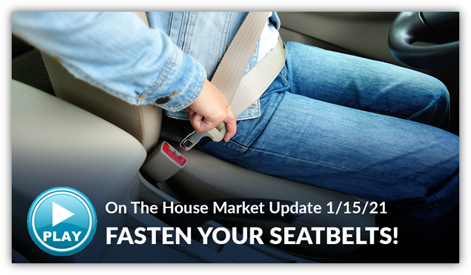 A person fastening their seatbelt in a car