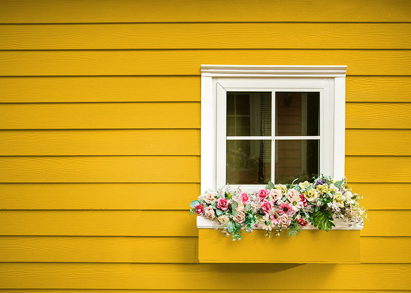 Yellow house with flower box