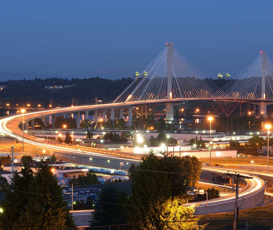 A bridge at night with Mount Rainer in the background